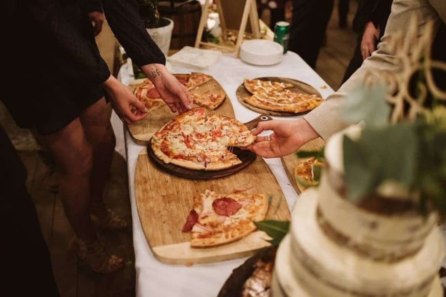 Wedding Guests Enjoying Pizza